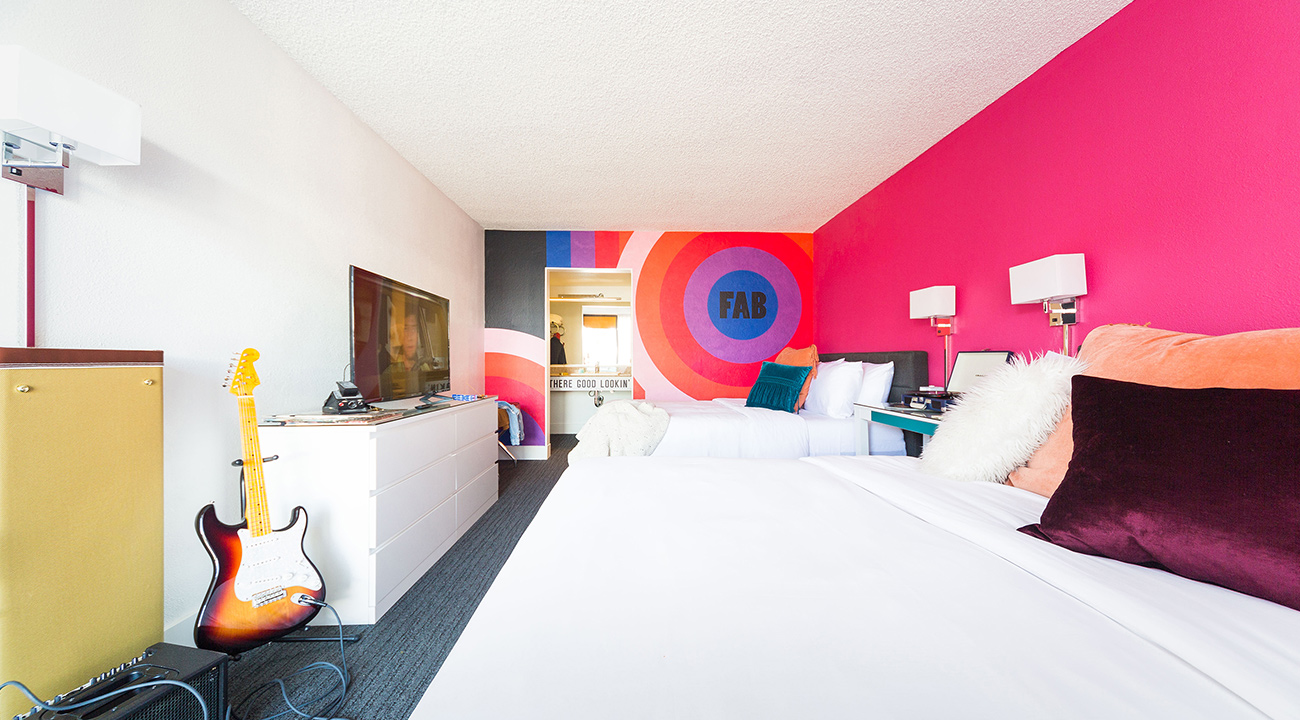 Rambler guestroom with FAB pink and purple wall art