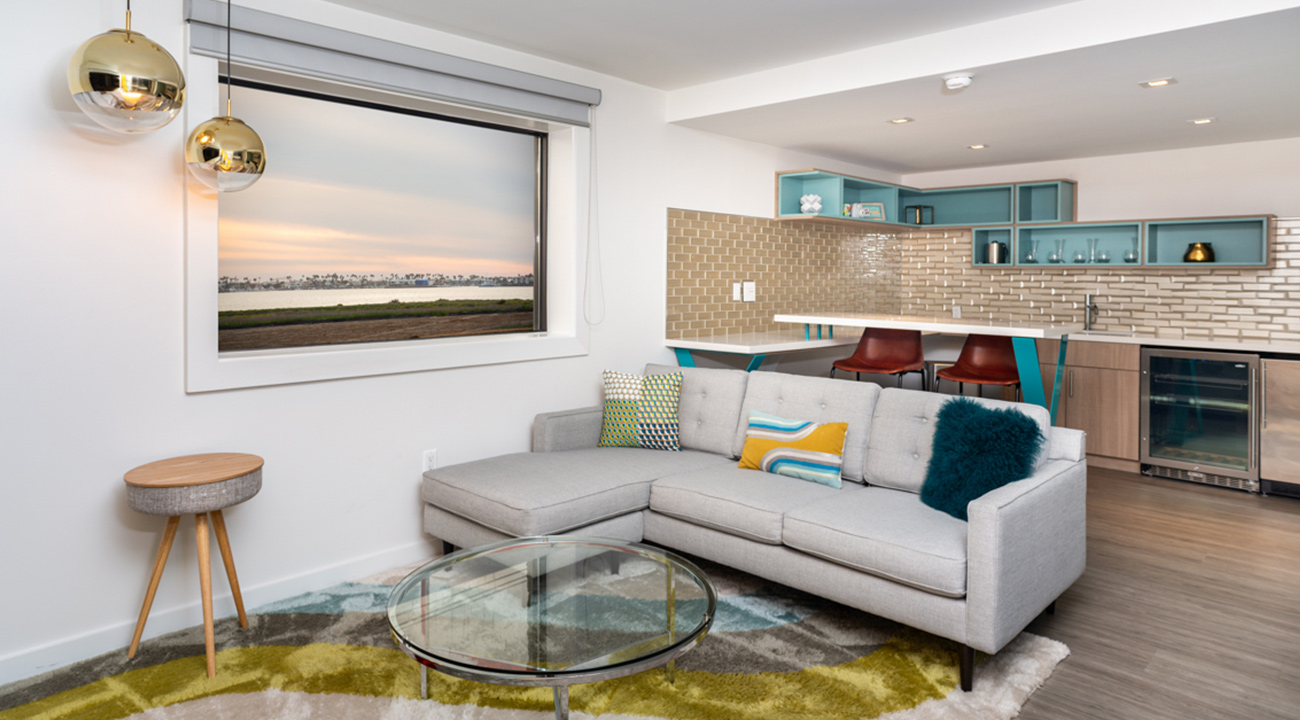 Rambler suite with couch and kitchen, view of bay from window