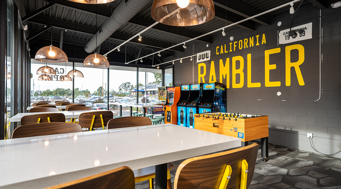 Rambler Coffee license plate mural and arcade in the cafe