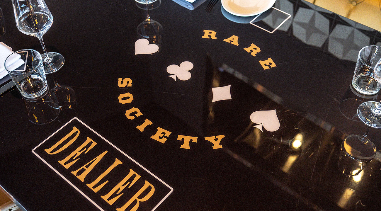Rare Society poker themed dealer dining table with glassware