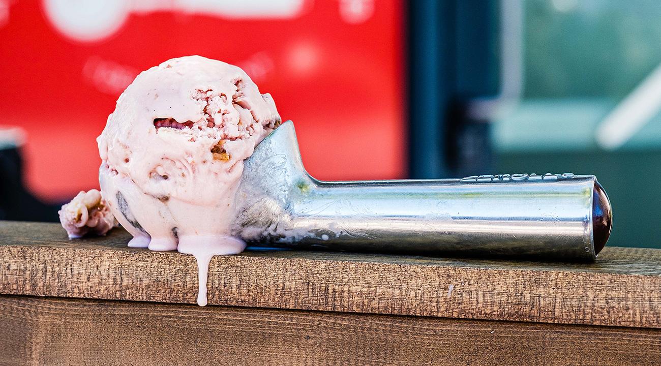 Scoop of ice cream melting